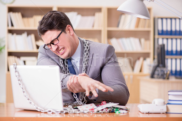 Young businessman addicted to online gambling cards playing in t Stock photo © Elnur