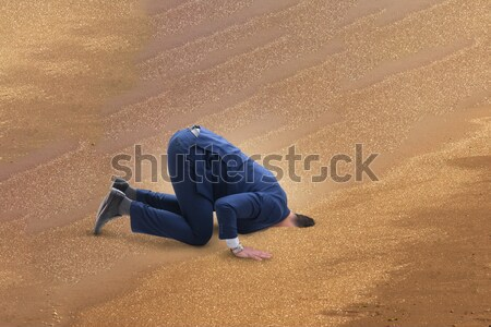 The businessman hiding his head in sand escaping from problems Stock photo © Elnur