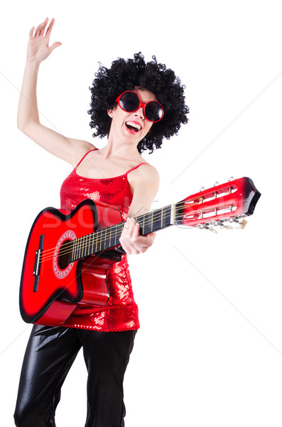 Stock photo: Young singer with afro cut and guitar