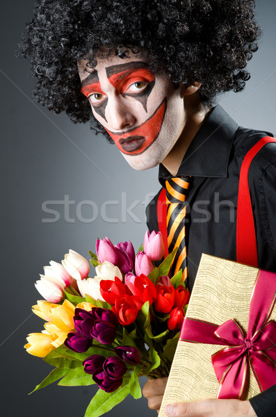 Sad clown with the flowers Stock photo © Elnur
