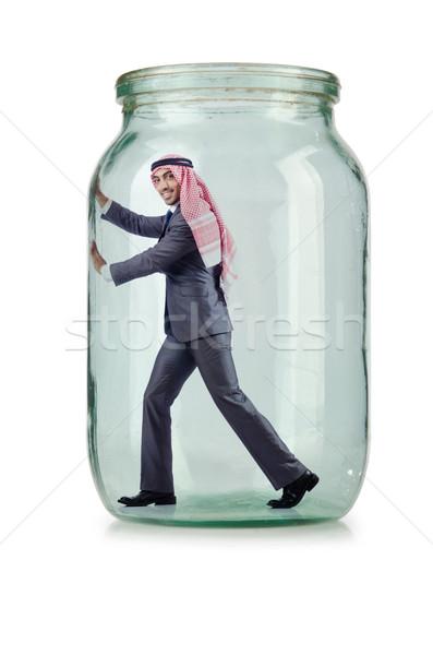 Arab businessman in glass jar Stock photo © Elnur