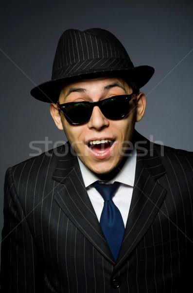 Junger Mann gestreift Kostüm hat isoliert Stock foto © Elnur
