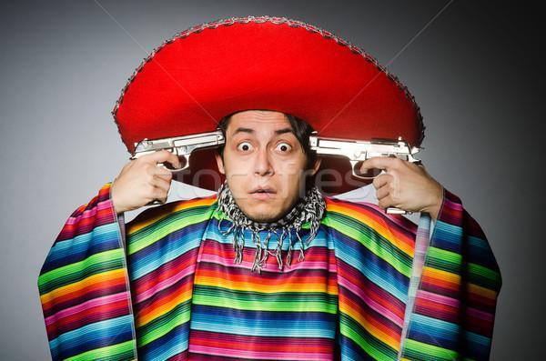 Férfi élénk mexikói tart kézifegyver szürke Stock fotó © Elnur