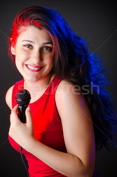 Kobieta śpiewu karaoke klub strony włosy Zdjęcia stock © Elnur