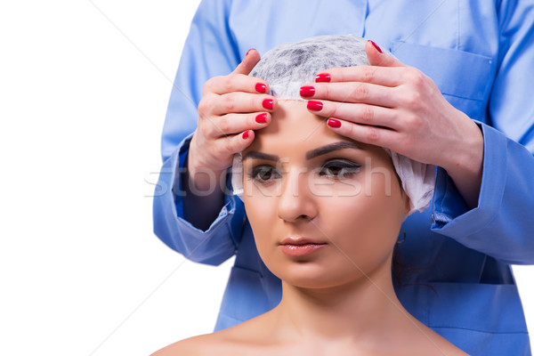 The beautiful young woman during face massage session Stock photo © Elnur