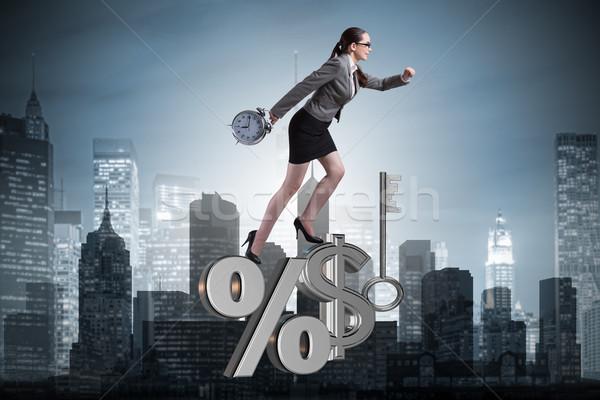 Businesswoman in high interest rates concept Stock photo © Elnur