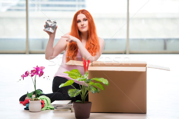The young woman moving house in lifestyle concept Stock photo © Elnur