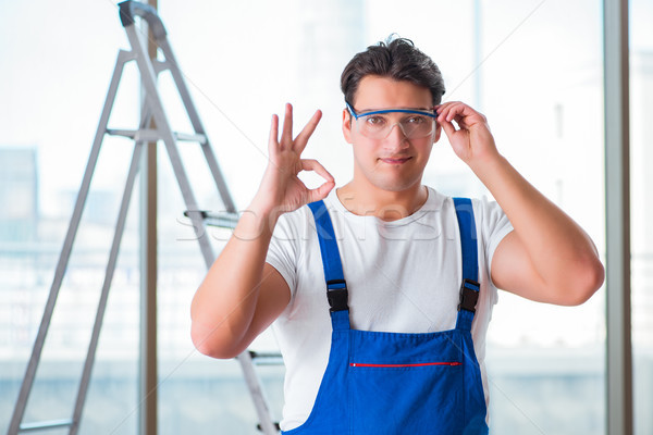 The young worker with safety goggles Stock photo © Elnur