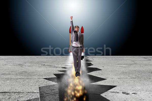 Empresário voador foguete rocha lacuna negócio Foto stock © Elnur
