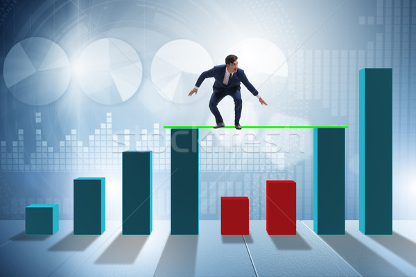 Young businessman in business concept with bar charts Stock photo © Elnur