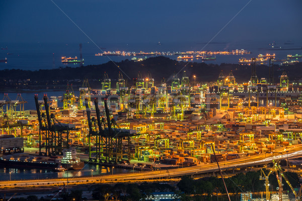 Singapore container port during evening hours Stock photo © Elnur