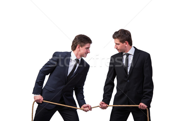 Twin brothers in tug of war concept isolated on white Stock photo © Elnur