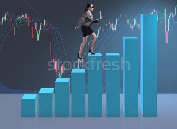 Imprenditrice climbing carriera scala commerciante mediatore Foto d'archivio © Elnur