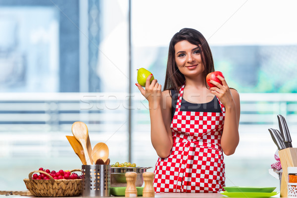 Young cook with fruits in the kitchen Stock photo © Elnur