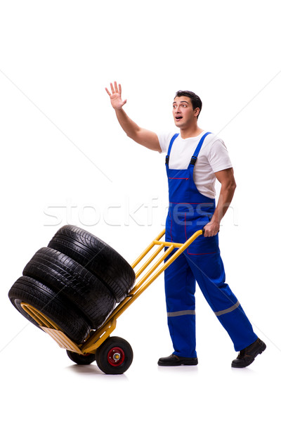 Stock photo: Handsome tyre repairman isolated on white