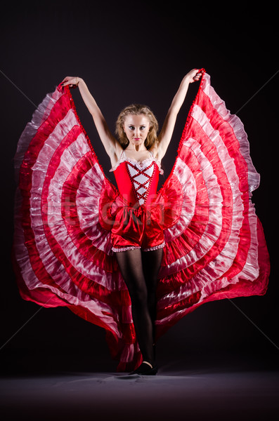 Young woman dancing in red dress Stock photo © Elnur