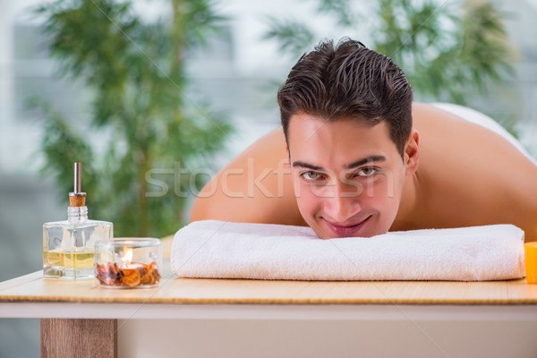 Handsome man during spa massaging session Stock photo © Elnur