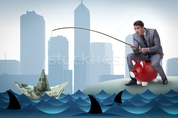 Businessman fishing out dollars from water Stock photo © Elnur