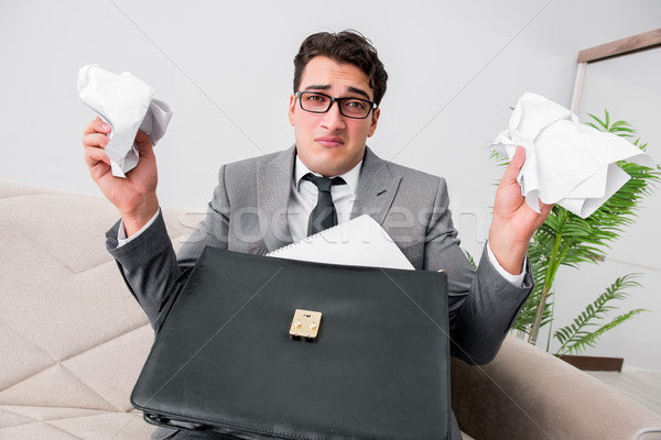 Angry businessman with crumbled paper Stock photo © Elnur
