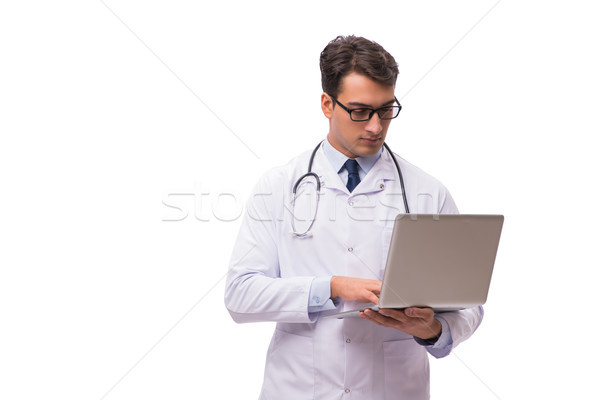Doctor with laptop isolated on white background Stock photo © Elnur