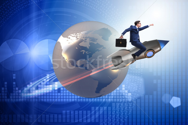 Businessman on the rocket in global business concept Stock photo © Elnur