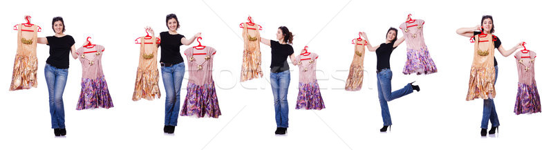 Woman trying to choose dress on white Stock photo © Elnur