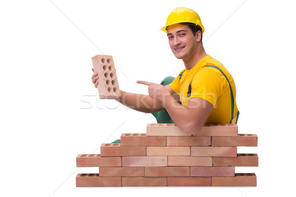 The handsome construction worker building brick wall Stock photo © Elnur