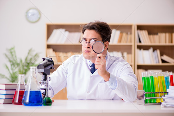 The mad crazy scientist doctor doing experiments in a laboratory Stock photo © Elnur