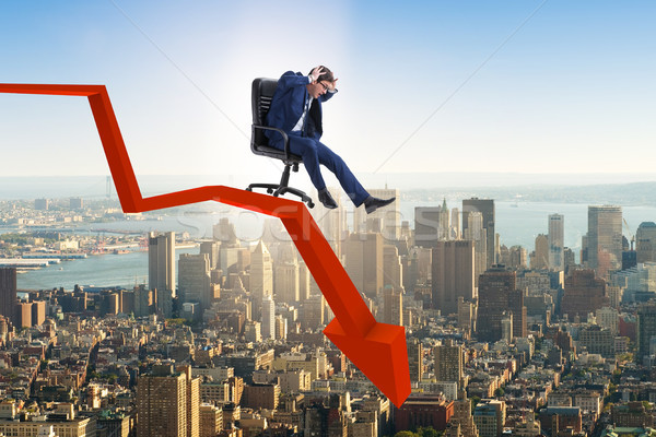The businessman sliding down on chair in economic crisis concept Stock photo © Elnur