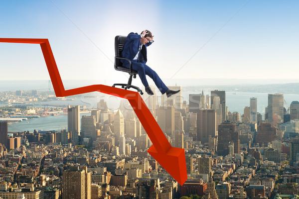 The businessman sliding down on chair in economic crisis concept Stock photo © Elnur