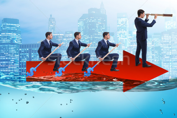 Teamwork concept with businessmen on boat Stock photo © Elnur