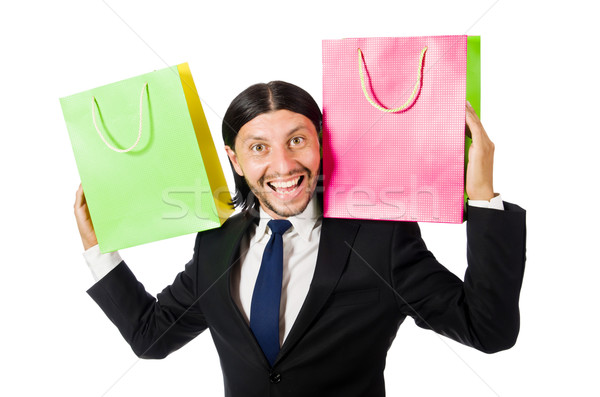 Man with shopping bags isolated on white Stock photo © Elnur