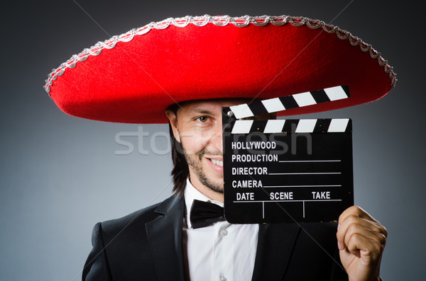 Mexican man with movie board clapboard Stock photo © Elnur