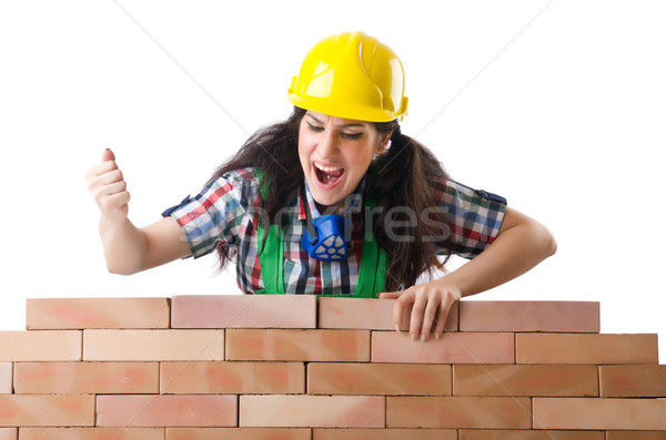 Woman builder isolated on the white Stock photo © Elnur