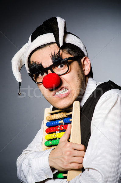 Funny clown with abacus in accounting concept Stock photo © Elnur