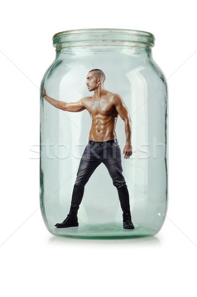 Muscular ripped man in glass jar Stock photo © Elnur