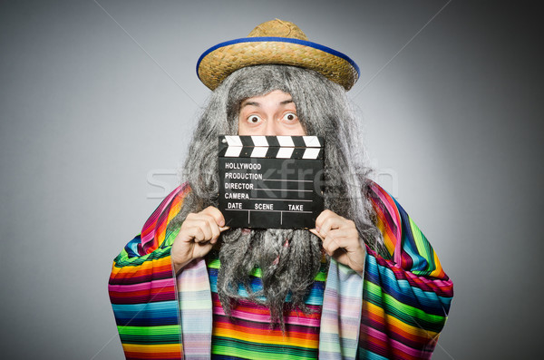 Funny hairy mexican with movie clapper Stock photo © Elnur