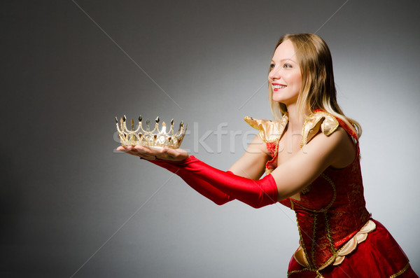 Queen in red costume against dark background Stock photo © Elnur