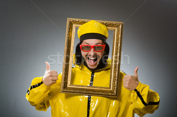 Man wearing yellow suit with picture frame Stock photo © Elnur