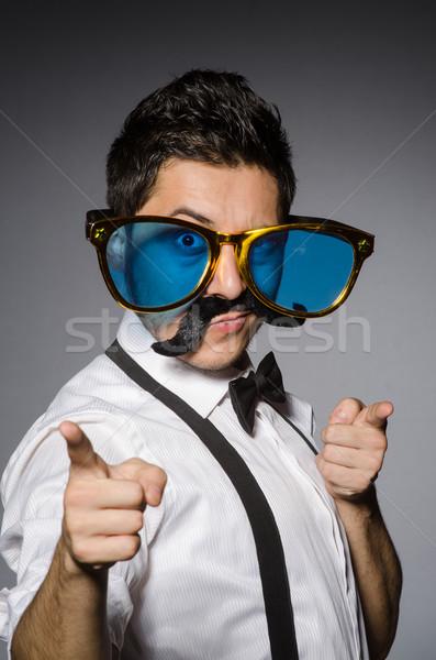 Młody człowiek fałszywy wąsy odizolowany szary moda Zdjęcia stock © Elnur