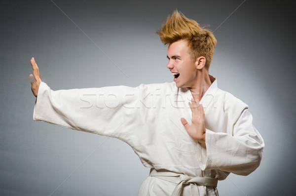 Drôle karaté lutteur blanche kimono Photo stock © Elnur