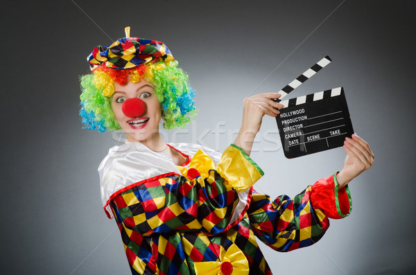 Clown with movie clapper in funny concept Stock photo © Elnur
