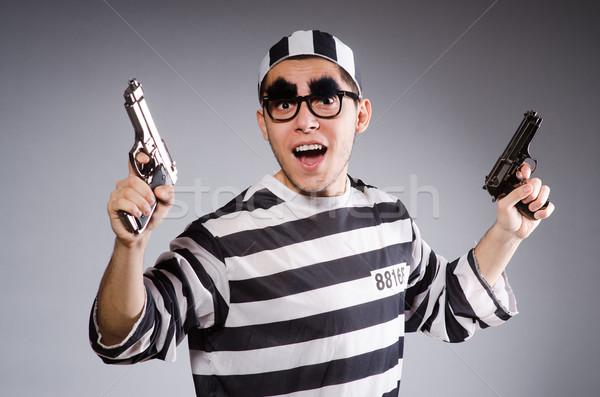 Jovem prisioneiro arma curta cinza pistola retrato Foto stock © Elnur