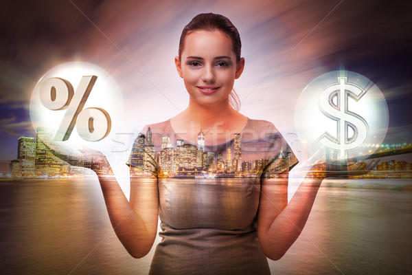 Businesswoman in high interest rates concept Stock photo © Elnur