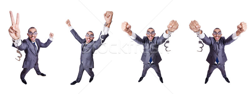 Funny businessman with handcuffs on white Stock photo © Elnur