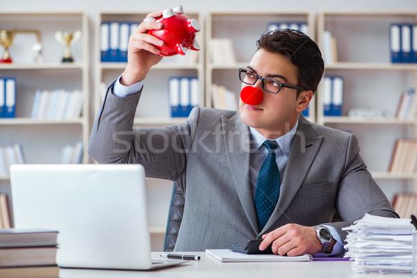 Palhaço empresário piggy bank contabilidade homem trabalhar Foto stock © Elnur