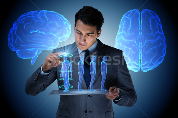 Futuristic remote diagnostics concept with businessman Stock photo © Elnur