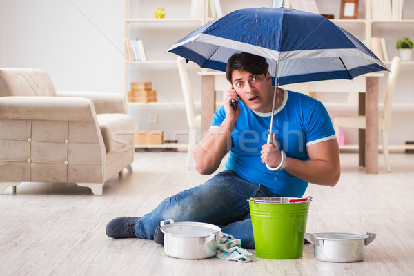 Man at home dealing with neighbor flood leak Stock photo © Elnur