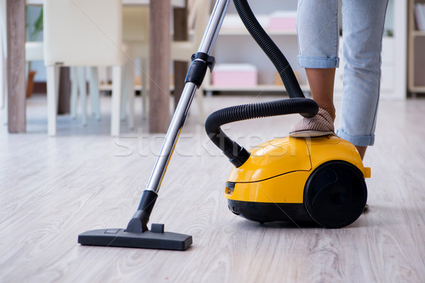 Woman doing cleaning at home with vacuum cleaner Stock photo © Elnur