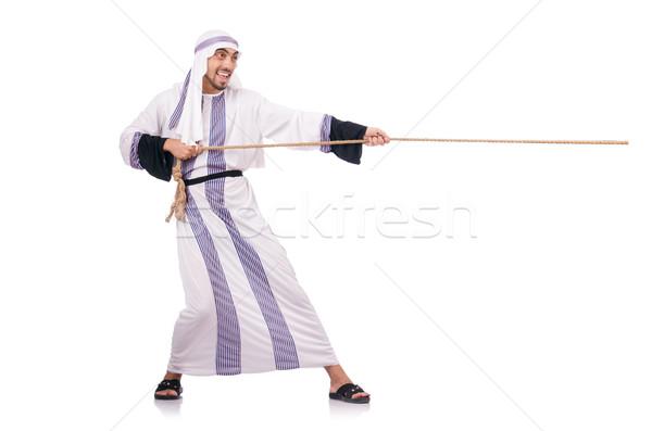 Arab man in tug of war concept Stock photo © Elnur